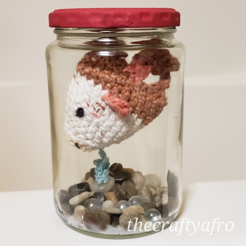 Crochet fish in a jar.